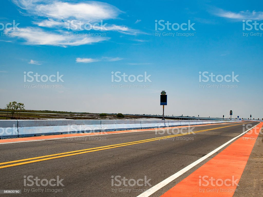 Road. Asphalt road with clouds blue sky in summer day stock photo