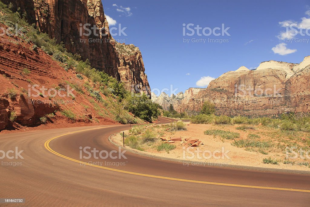 Road between red rocks, Zion National Park, Utah, USA royalty-free stock photo