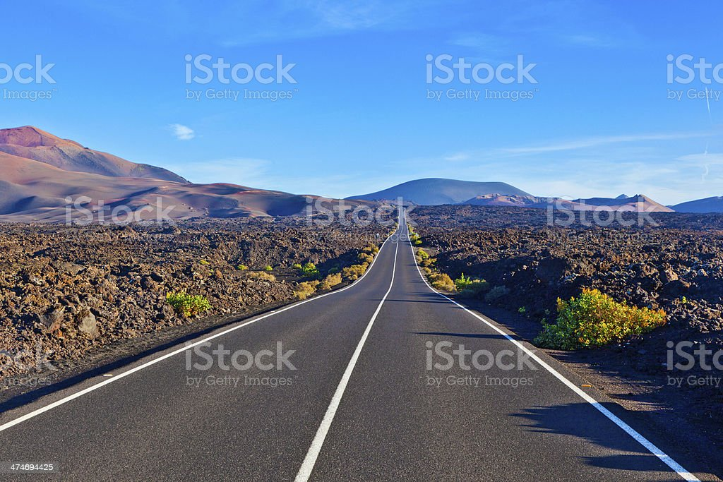 Road between rocks  in Timanfaya national Park stock photo