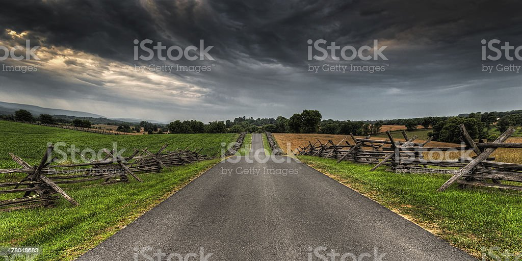 Road Between Split-Rail Fences royalty-free stock photo