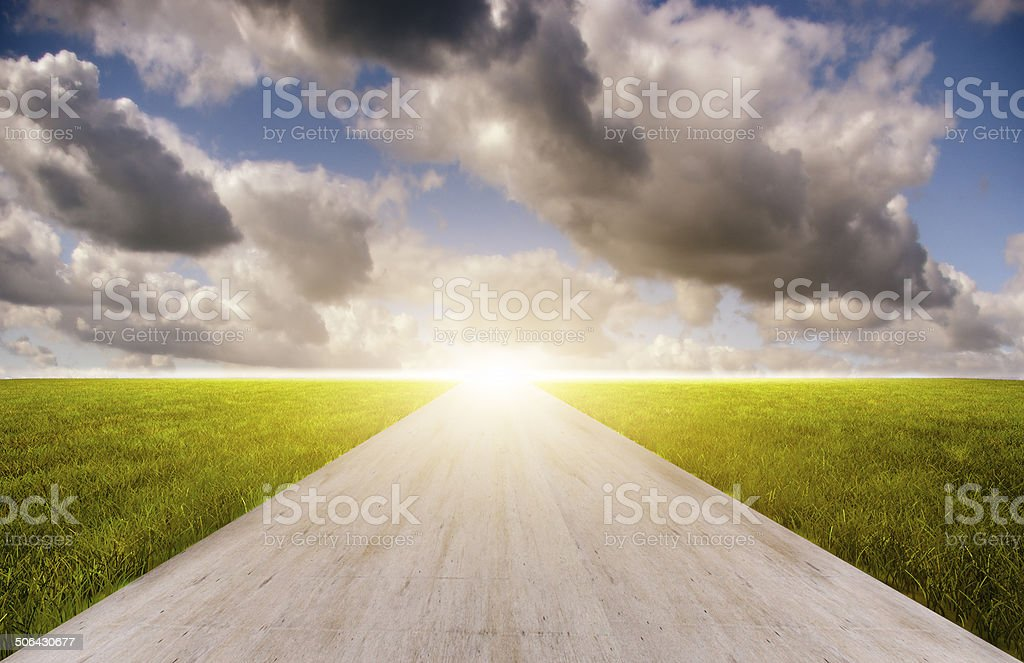 Road between the meadow with Moving Clouds stock photo