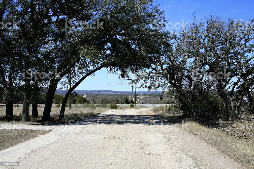 Road between the trees in Texas Hill Country. royalty-free stock photo