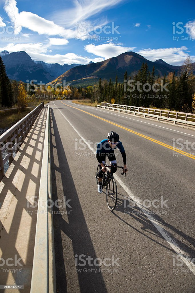 Road Bicyclist on Bridge stock photo