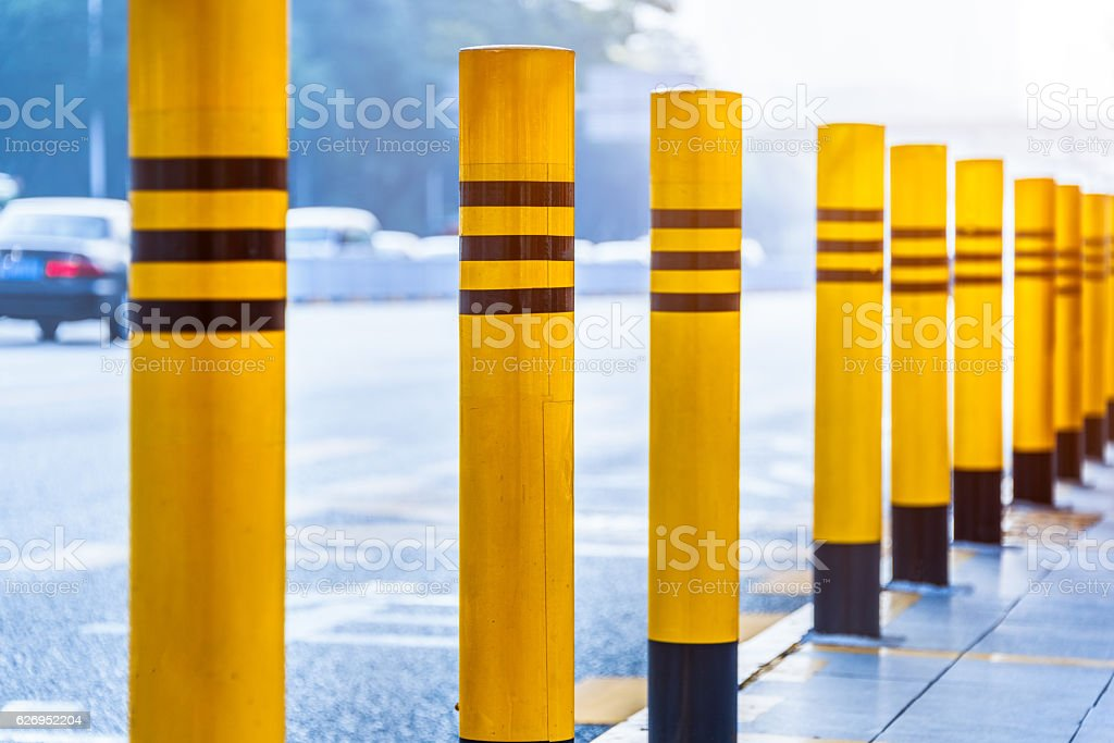 Road block pole in straight line stock photo