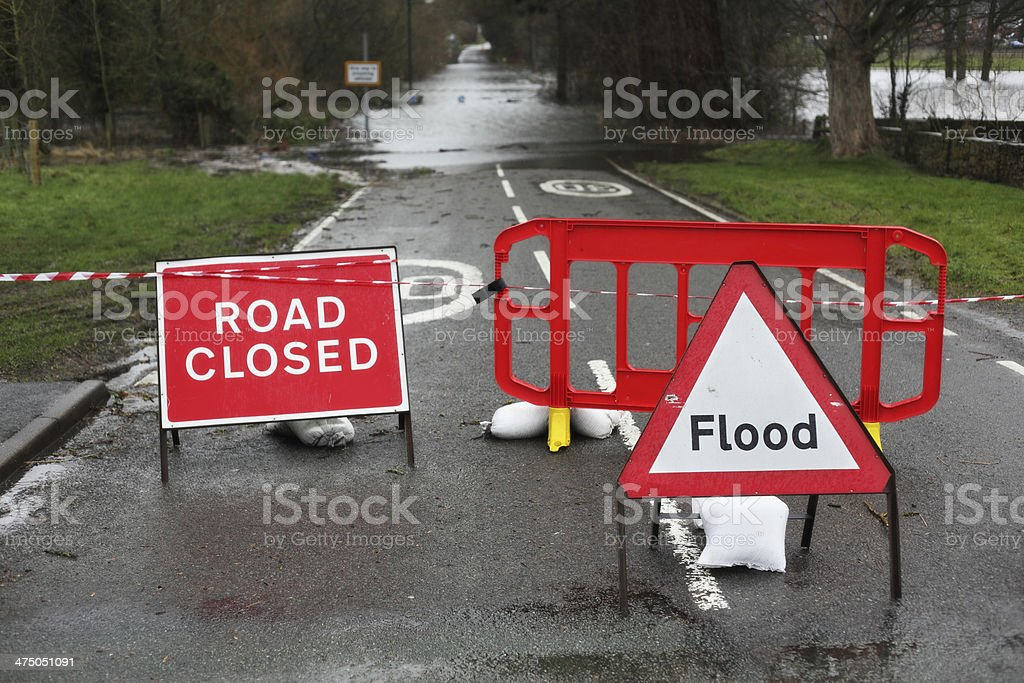 Road closed and flood sign stock photo
