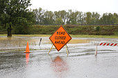 Road Closed Sign Warning of Rain Flooded Road