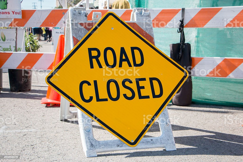 Road Closed Sign with Barricade in Background stock photo
