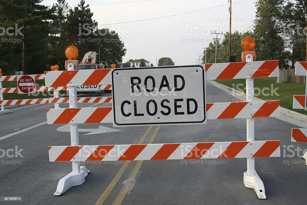 Road closed sign with other blockades in the background stock photo