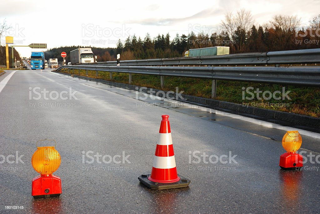 road closed, traffic cone and warning lights stock photo