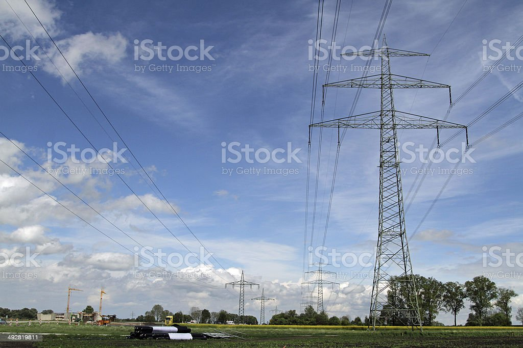 Road Construction and Energy power line stock photo
