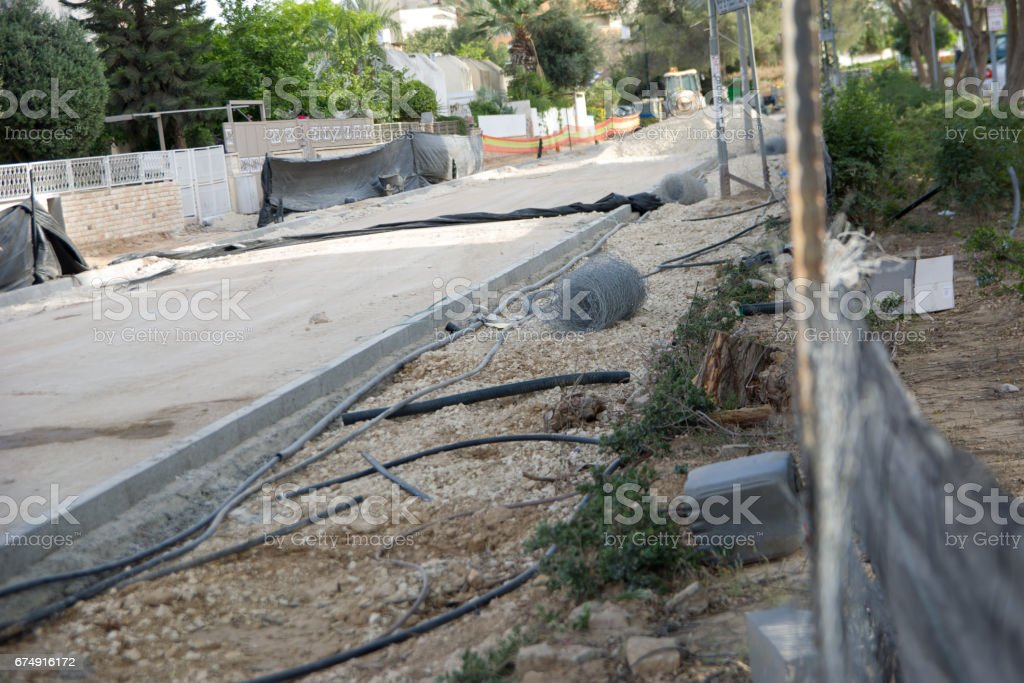 Road Construction And Repairs constraction trash cutted electric cabels stock photo