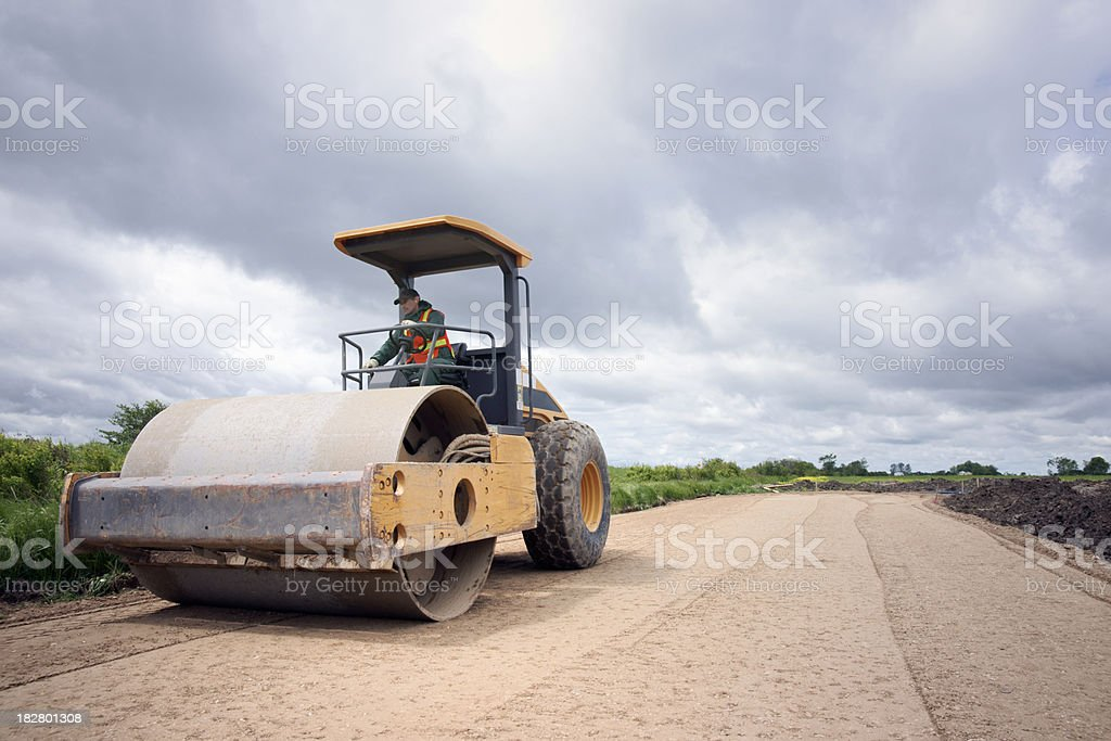 Road construction and stormy skies royalty-free stock photo