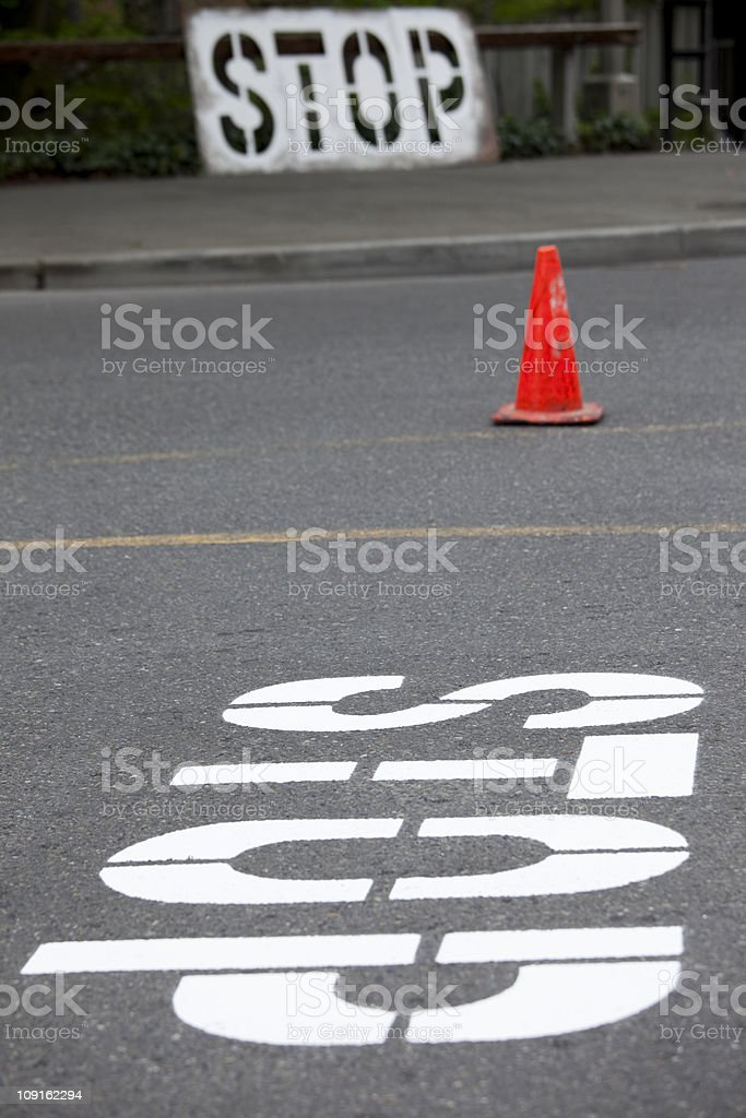 Road construction crew paints Stop Sign and crosswalks on street royalty-free stock photo