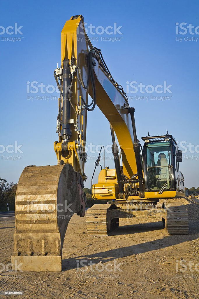 Road construction equipment in Sunset stock photo