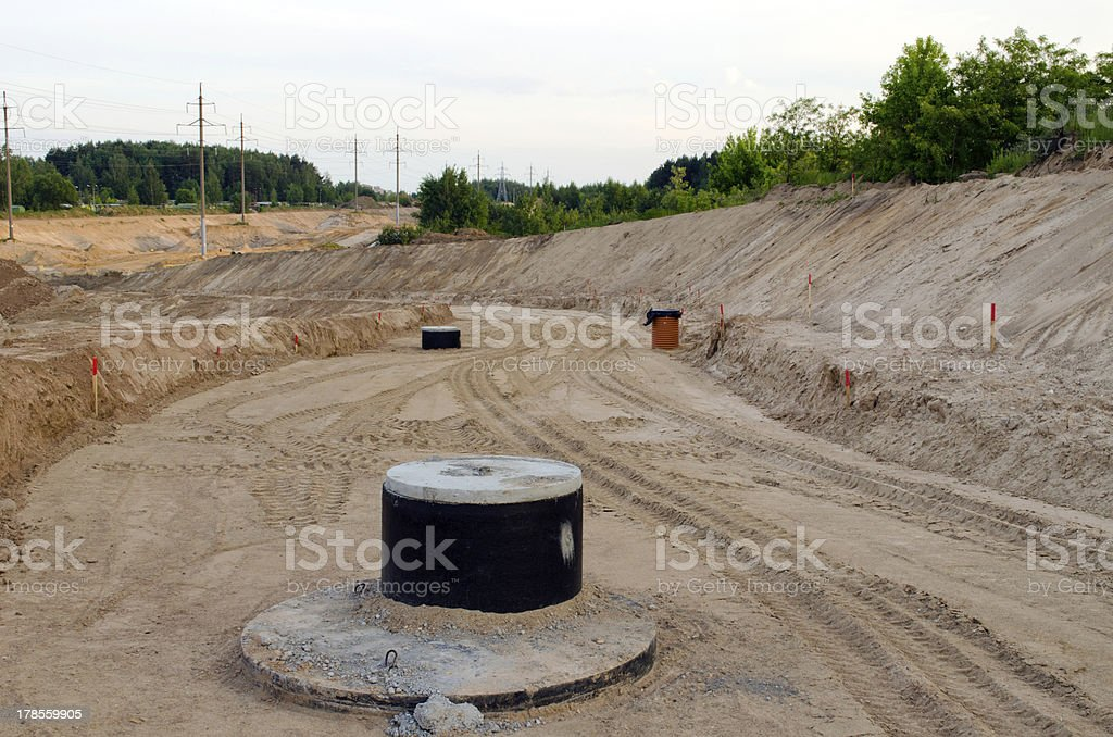 Road construction.  Gravel  sewage wells royalty-free stock photo