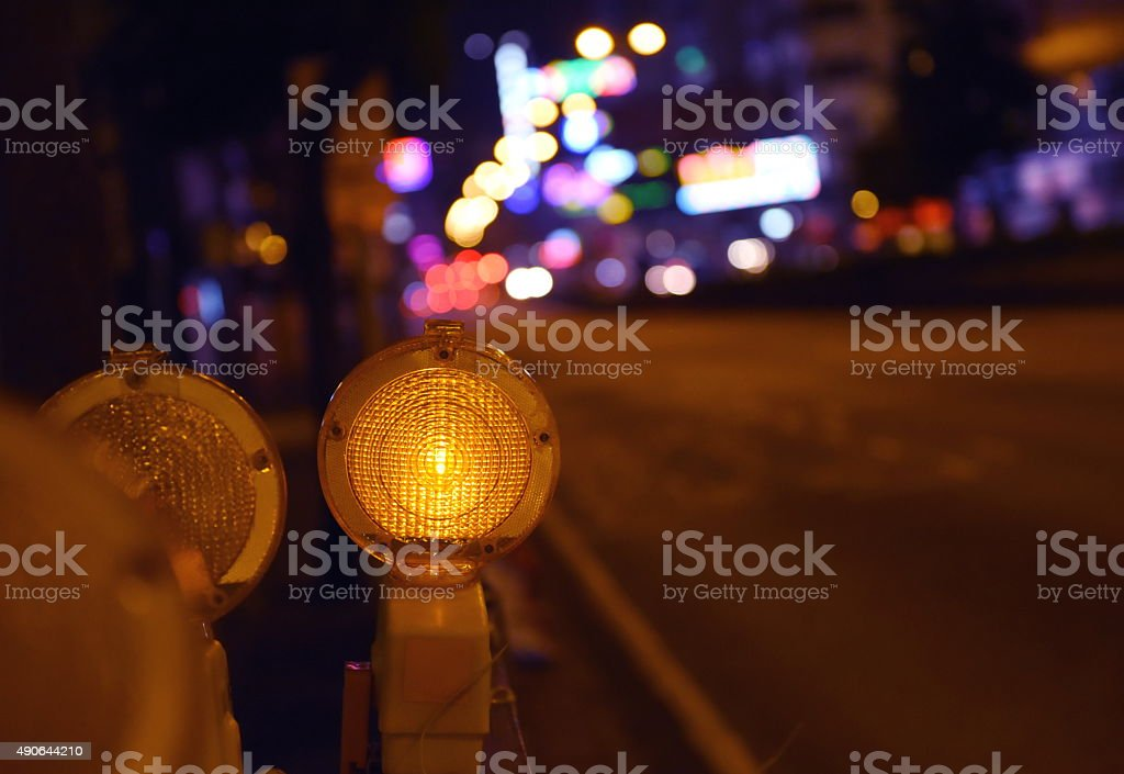 Road construction light at night in the city stock photo