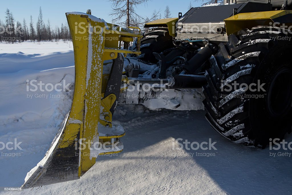Road construction on the winter road. stock photo