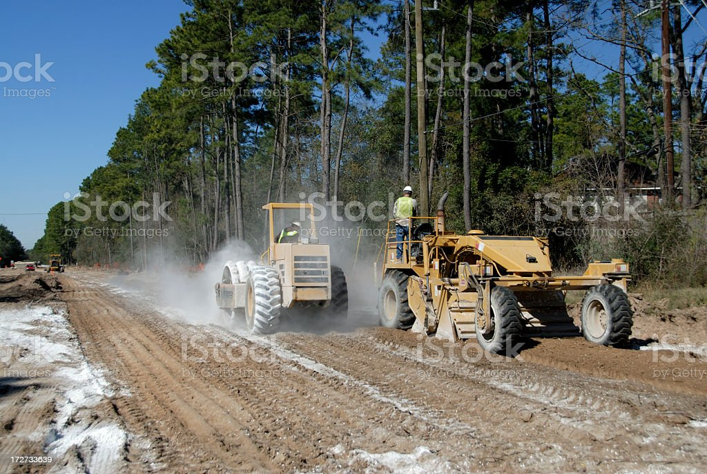 Road Construction- Tiller And Compactor Stabilizing The Soil royalty-free stock photo