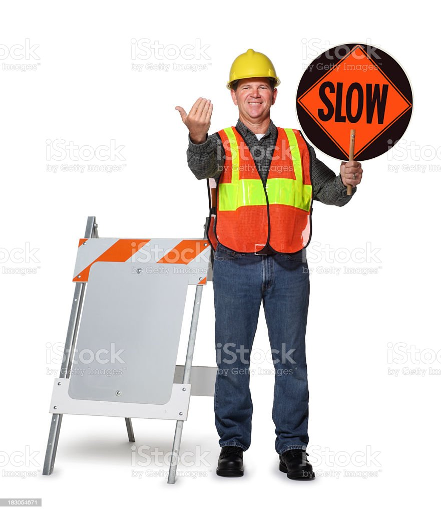 Road construction worker holding slow sign on white background stock photo