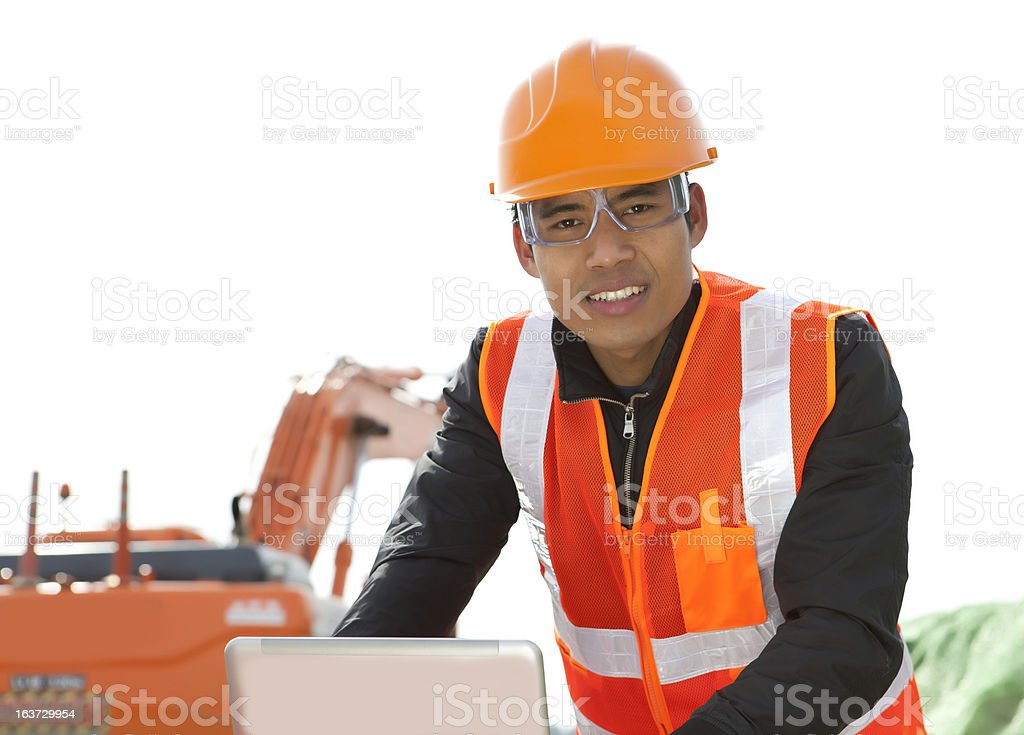 road construction worker using laptop royalty-free stock photo