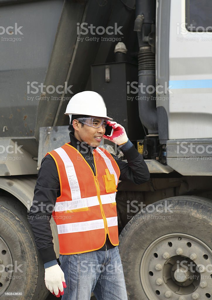 road construction worker using mobile phone royalty-free stock photo