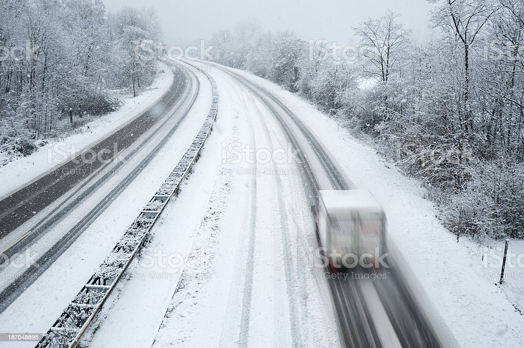 Road covered with snow and ice stock photo