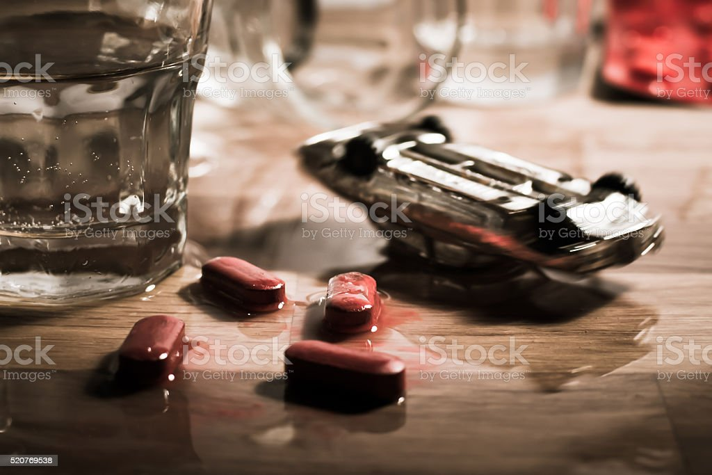Road crash on a table - drunk driving metaphor stock photo