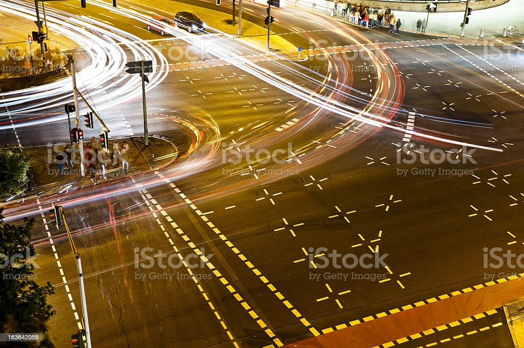 Road crossing at night from above stock photo