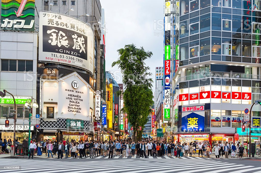 Road Crossing Shinjuku Shopping With Crowds and Signs stock photo