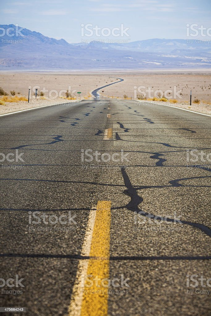 Road Crossing the Desert of Death Valley, California royalty-free stock photo