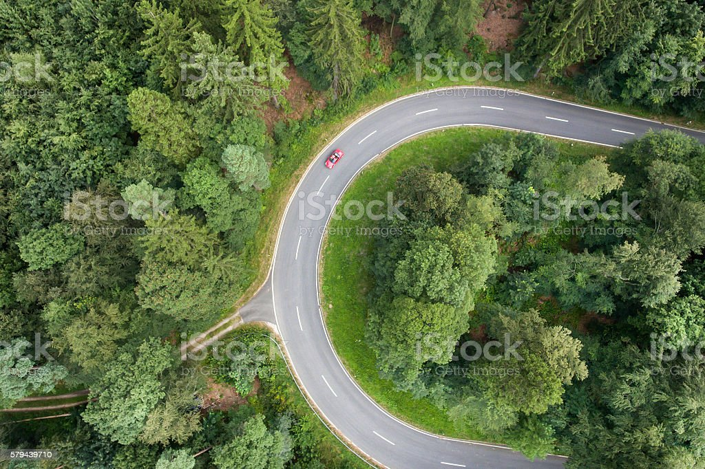 Road curve in the forest. Aerial view. stock photo