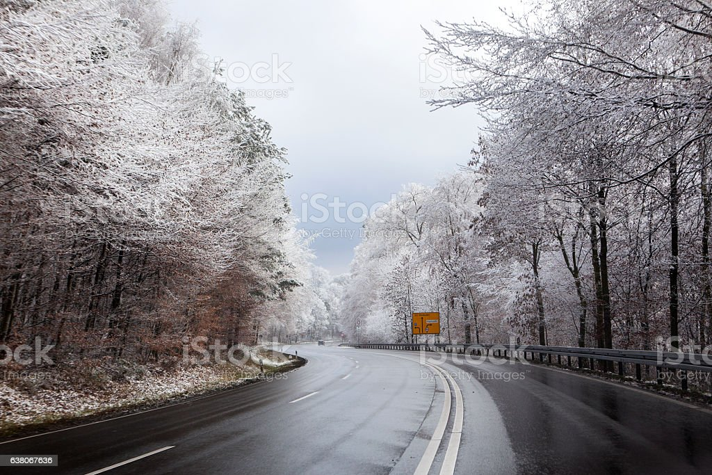 Road curve wintery forest hoar frost stock photo