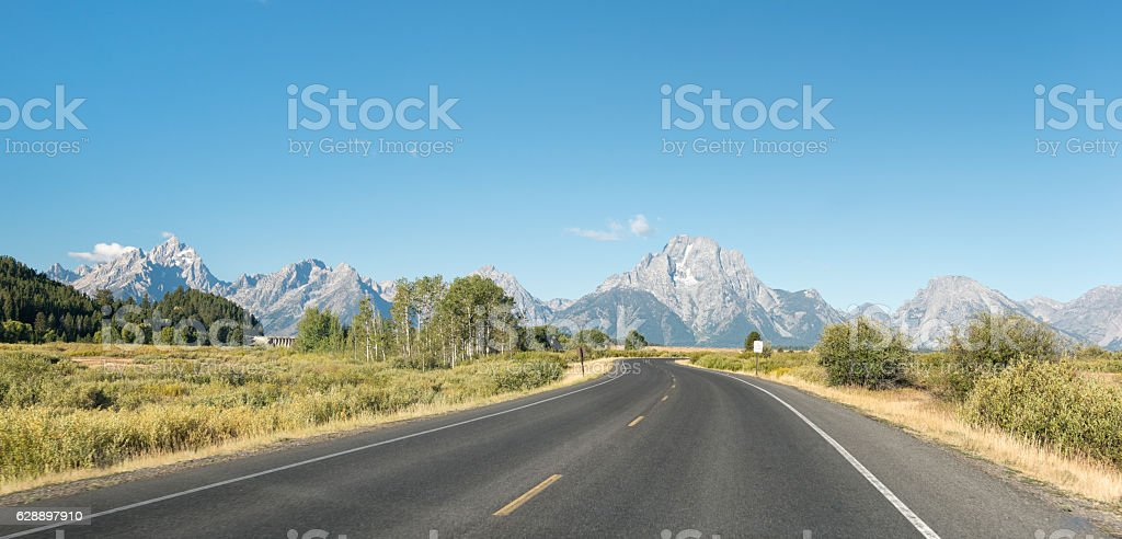 Road curving through Grand Teton National Park, USA stock photo
