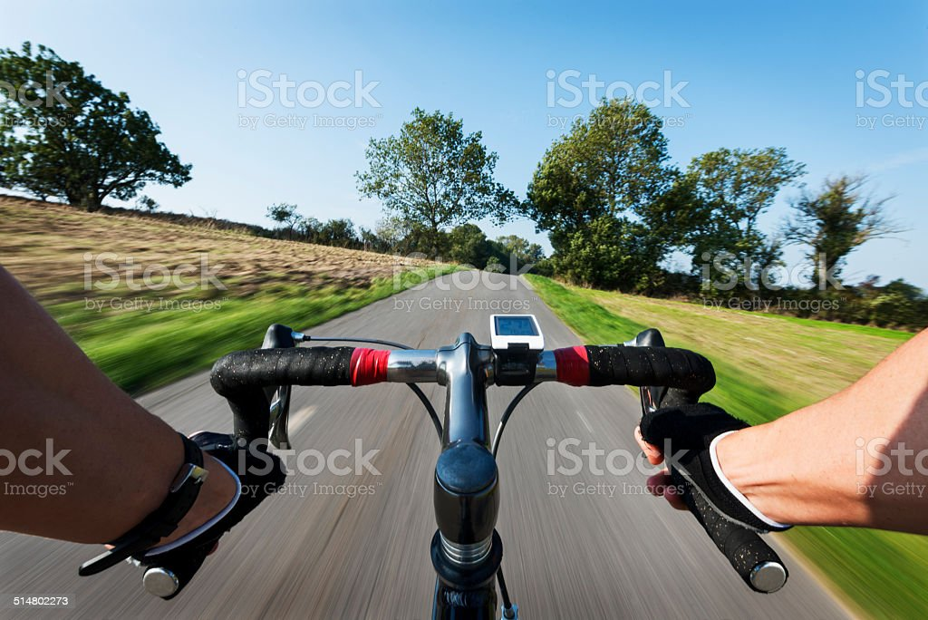 Road Cycling From Riders Perspective With Speed Blur stock photo