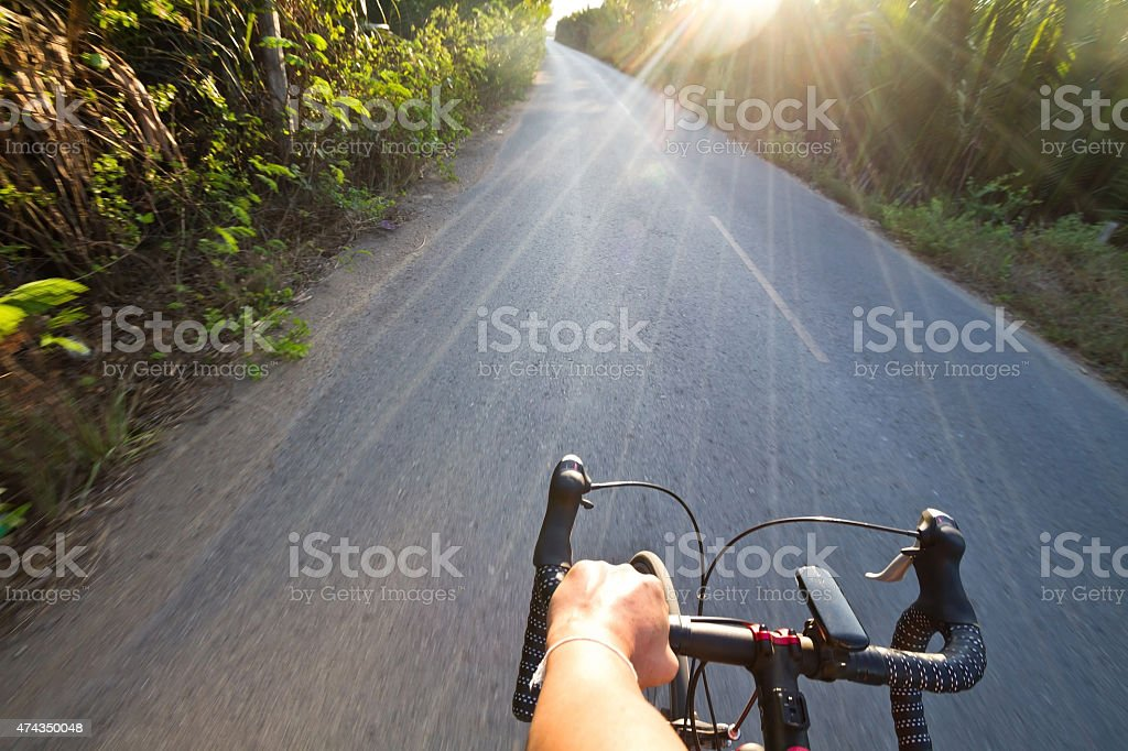 Road cycling wide angle speed shoot stock photo