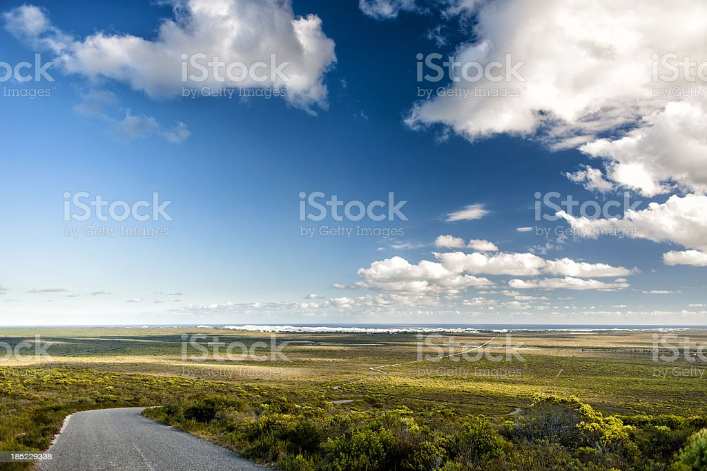 Road down a hill with wide panoramic view royalty-free stock photo