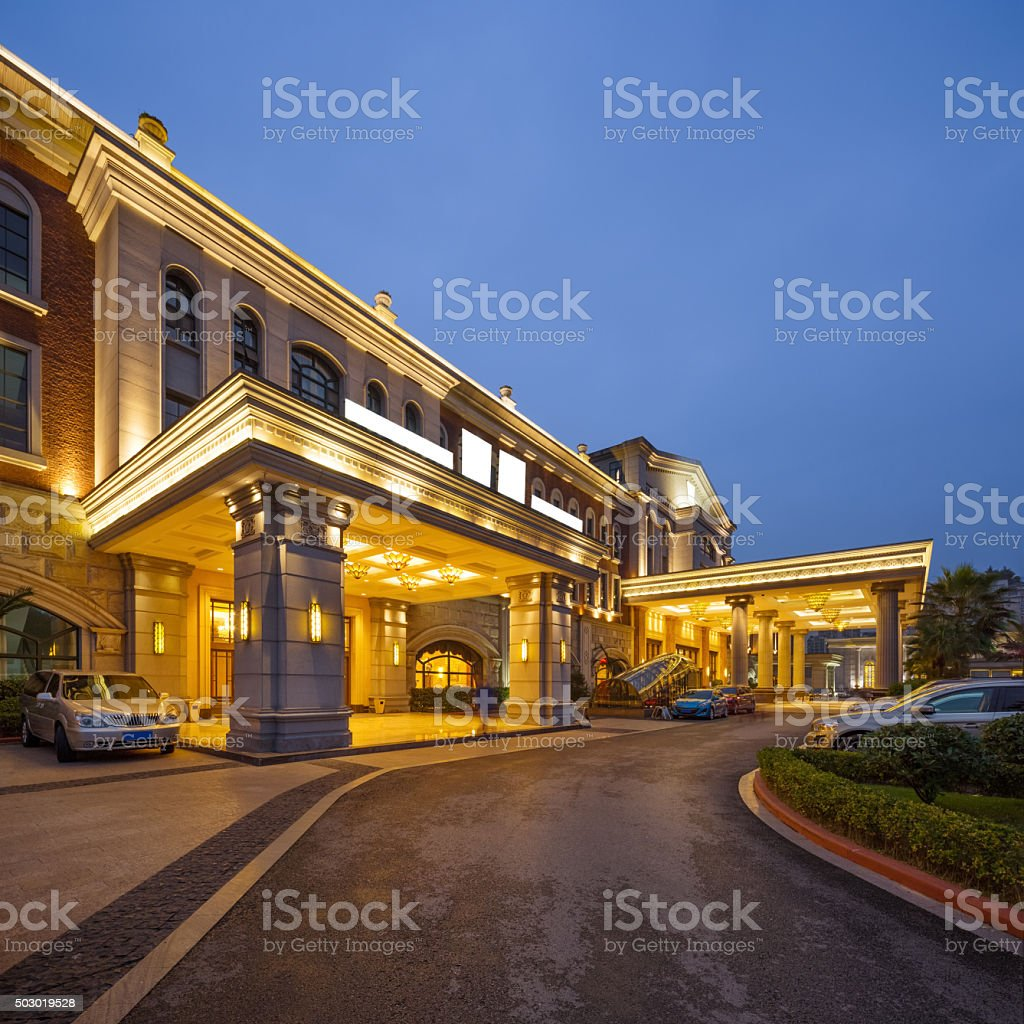 road front of luxury building in clear sky at night stock photo