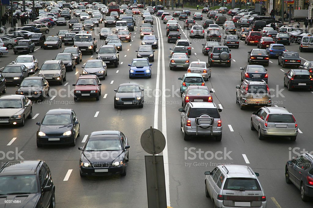 Road full of traffic with cars bumper to bumper stock photo