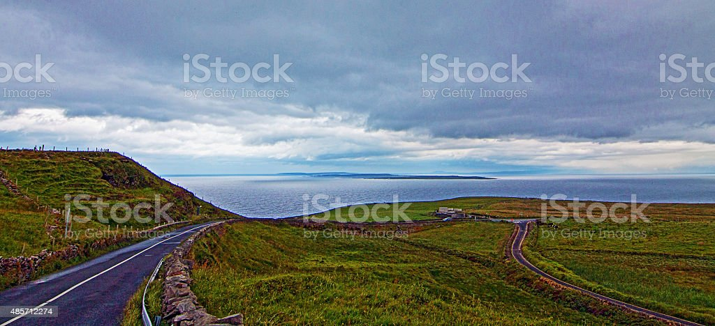 Road going past Cliffs of Moher in County Clare Ireland stock photo