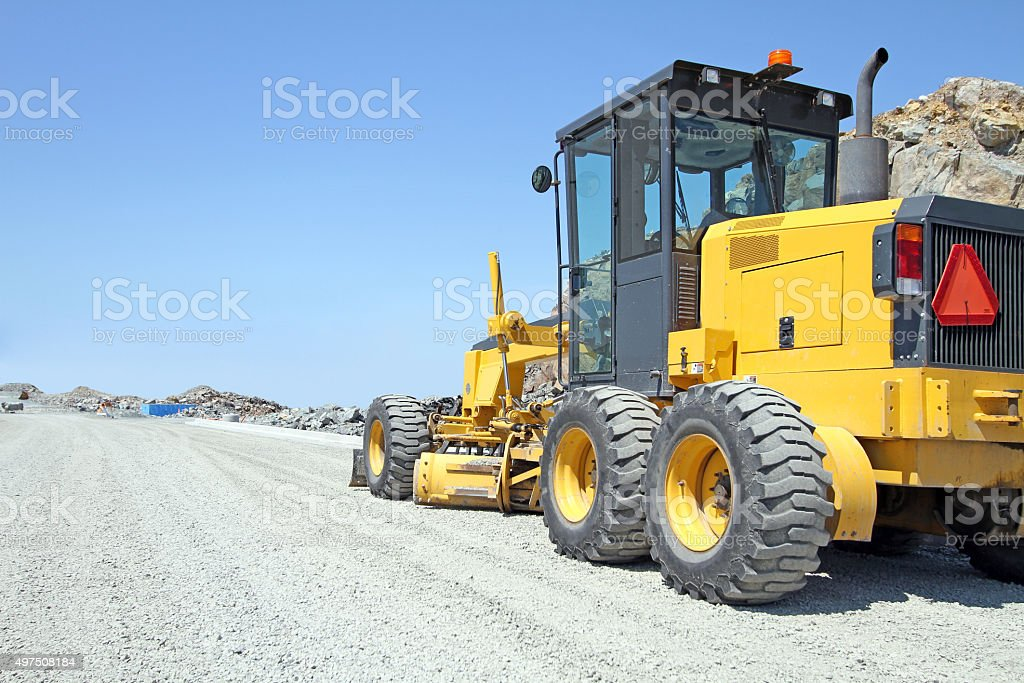 Road Grader Machine On A New Road Construction Site stock photo