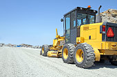 Road Grader Machine On A New Road Construction Site