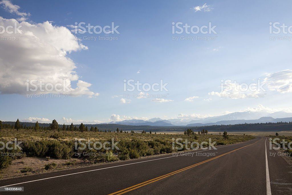 Road Heading Towards the Mountains on a Beautiful Day royalty-free stock photo