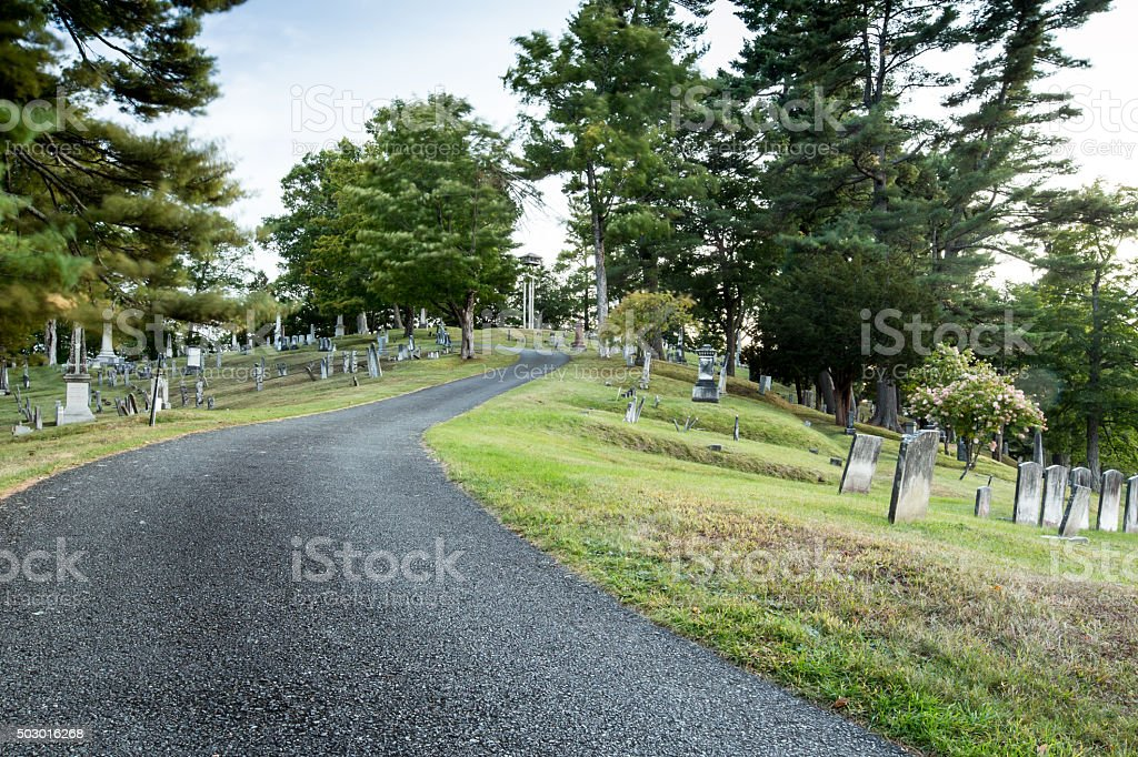 road in a cemetery stock photo