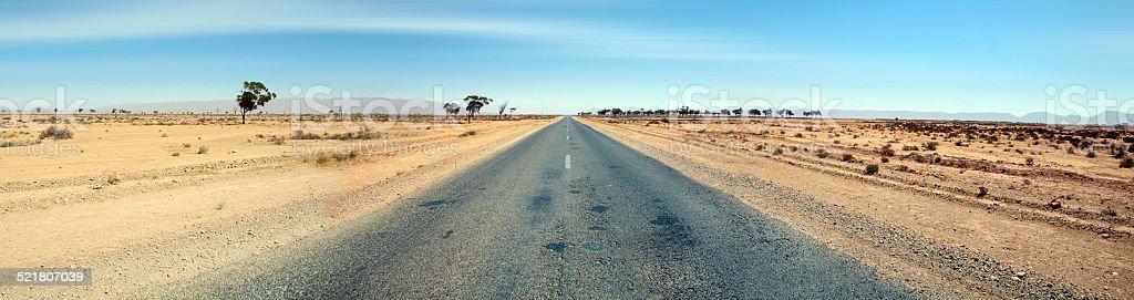 Road in arid landscape of Tata, Morocco stock photo