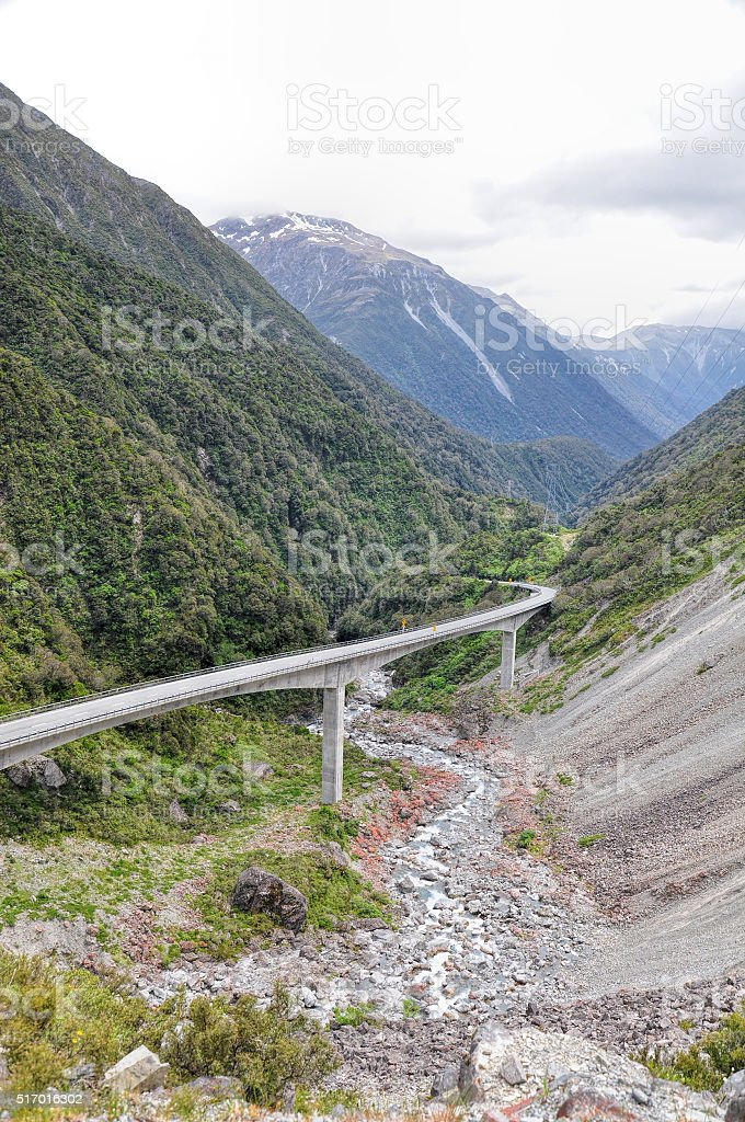 Road in Arthur pass and high mountains, South island, New stock photo