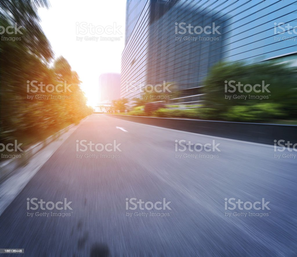 road in city with sunset royalty-free stock photo