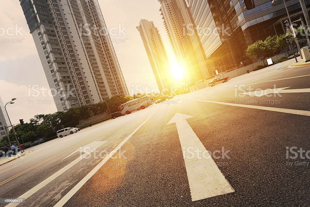 road in city with sunset stock photo