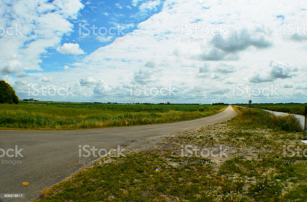 Road in countryside the Netherlands, Groningen royalty-free stock photo