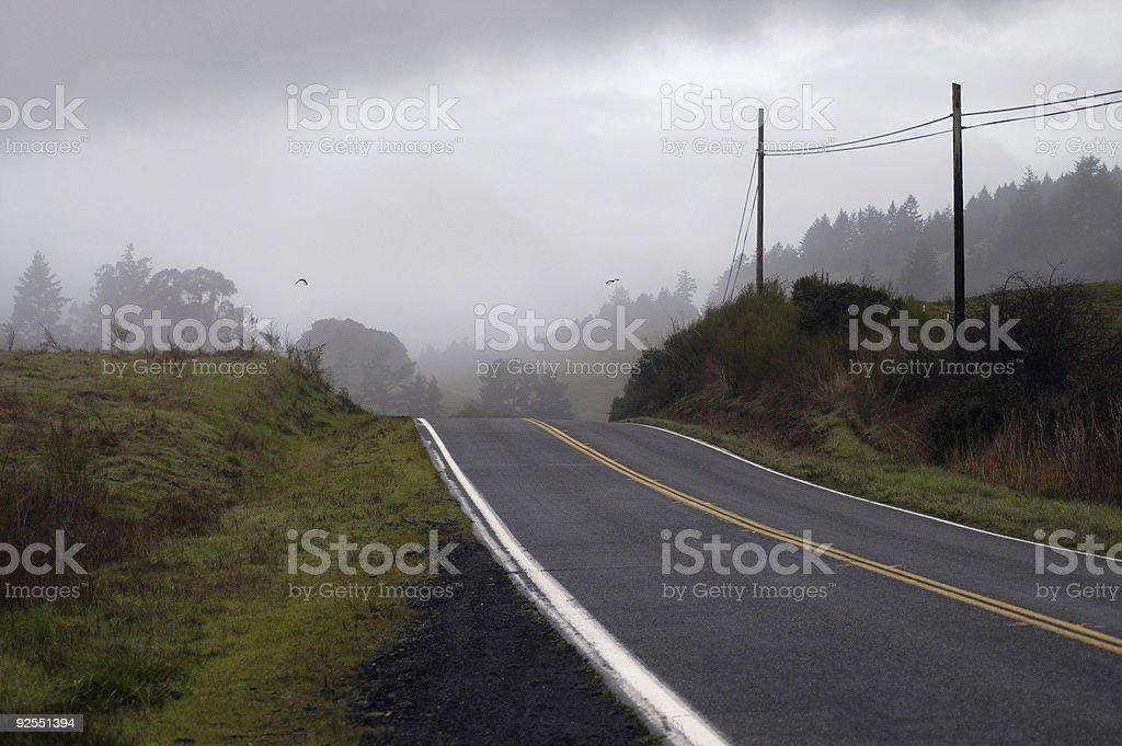 Road in dark fog stock photo