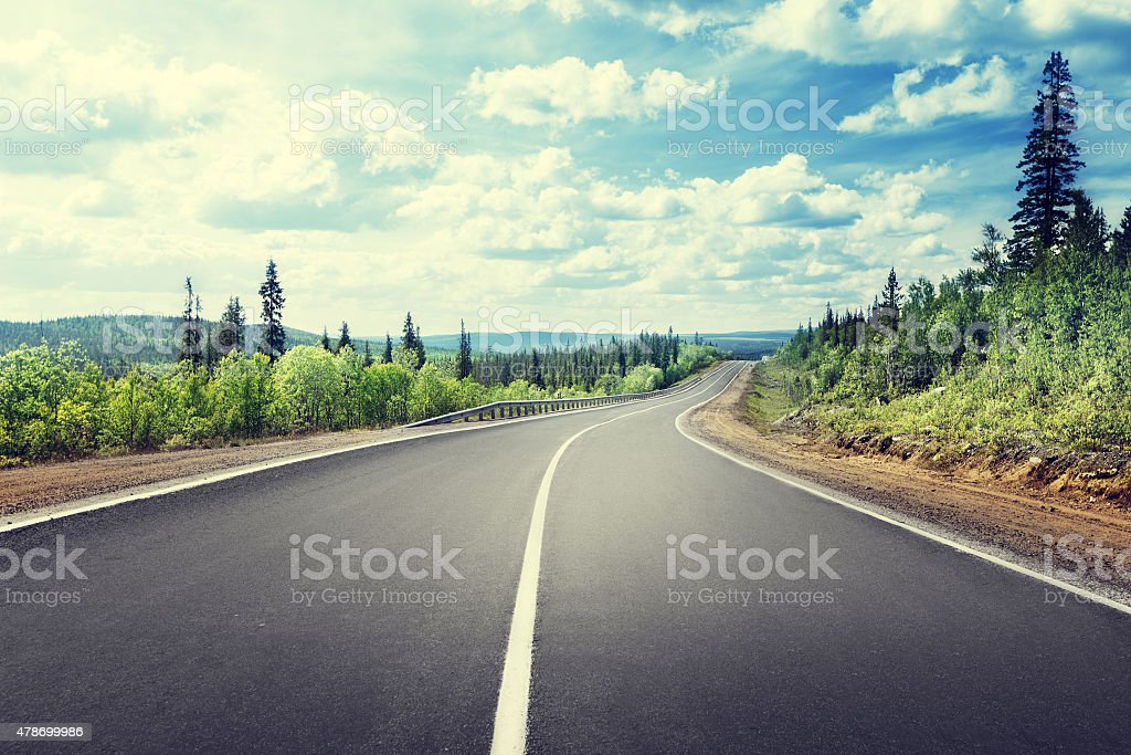 road in mountain forest stock photo